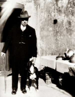This image shows Arthur Atkinson c.early 1930s, accompanied by his farm dog. Note the utensils in and on the sink.