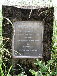 An image of the brass plaque at the location where it has been erected at the edge of the field by the roadside where the stricken plane came to a halt.
