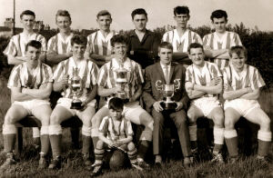 An image of Hillstown Miners Welfare F.C. - 1960s. Clearly a winning team. Image courtesy of Ms. Emma West.
