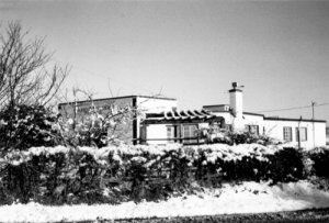 A winters day showing the new Hare and Hounds pub, though it is likely that at the time this image was taken, the name would have changed.