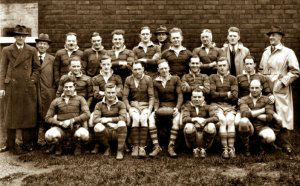 An image of Dukinfield rugby team, 1936/37, with two adult sons of the late Samuel Thomas and his wife Mary thereon. Claude is middle row, second from left, whilst his brother Sydney Thomas is fourth from left, holding the ball.  Image courtesy of Mrs Jill Cox.