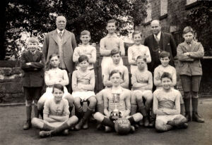 An image of Stainsby school fotball team 1931-2.  The Headmaster in the image is Mr. Reuben Fletcher, back row extreme left standing. The teacher is Mr. Holmes, who a few years later left the school to join the Forces during WW2.