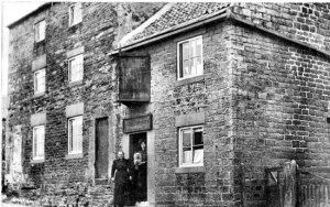 The old Hare and Hounds pub c1905/10. The licensee Hannah Wilcockson formerly Froggatt b.1861 is posing with a woman, holding a dog, who is most likely to be Clara Fletcher b.1871 at Baslow, her General Domestic Servant.