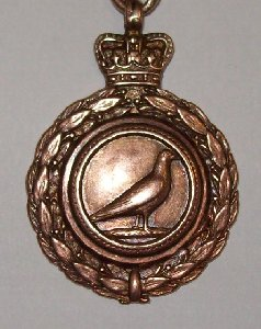 This is an image of the front of a medal awarded to T.Featherstone for for OBA (Old Bird Average) in Palterton 1925.  He had won the Young Bird Average a few years earlier