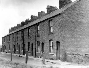 A 1960s image of houses Known as Ten Row on the east side of Scotland Yard shortly prior to demolition. House number Ten is nearest camera, house number One being furthest away.