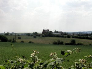 A modern (2004) image showing a view of Strelley Park and Farm from the edge of Babbington village. The miners cottages were located in the field (with the small square object) to the left of and almost adjoining the farm.