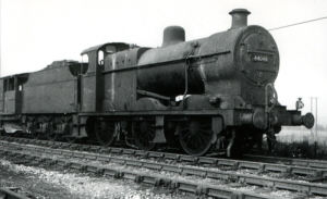 This image was taken on the 24 July 1960 and shows railway engine number 44049 on the railway line near Glapwell Colliery. This fright engine was one of 580 built, production starting in 1922. It was sometimes used on local passenger duties but mainly used to pull the coal wagons. This loco was sheded at Derby and Westhouses during the 1960s and scrapped about 1965.